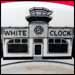 Interesting topmark of White Clock Hamburgers, showing building similar to other diners of that era with the addition of a coffee cup on top.